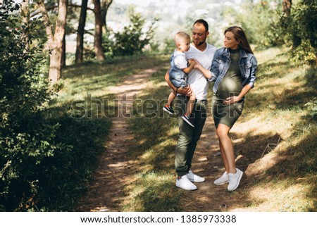Husband with pregnant wife and their son #1385973338