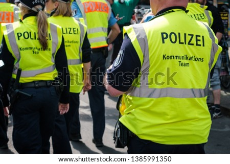 Berlin, Germany - May 01, 2019: Police team on street at myfest celebration on mayday , 1. mai, Berlin, Kreuzberg #1385991350