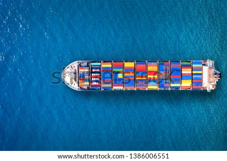 Aerial view of container cargo ship in sea. Royalty-Free Stock Photo #1386006551