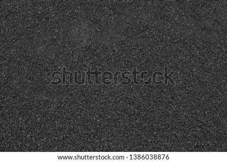 Asphalt close up texture. Raw asphalt texture #1386038876