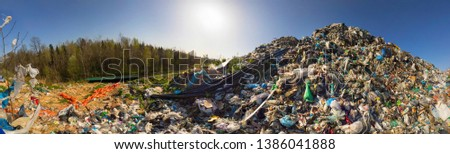 huge landfill site, a special device collects and pumps methane and other gases into storage. Gas through rubber pipes goes to tanks, alternative energy #1386041888
