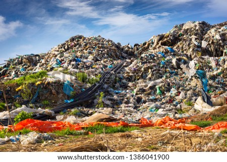huge landfill site, a special device collects and pumps methane and other gases into storage. Gas through rubber pipes goes to tanks, alternative energy #1386041900