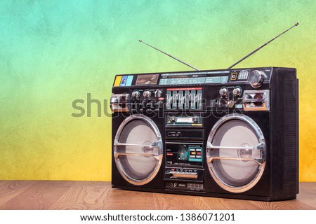 Retro boombox ghetto blaster outdated portable radio receiver with cassette recorder from 80s front gradient colored wall background. Rap, Hip Hop, R&B music concept. Vintage old style filtered photo #1386071201