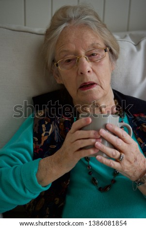old caucasian lady  sitting with a cup of tea #1386081854