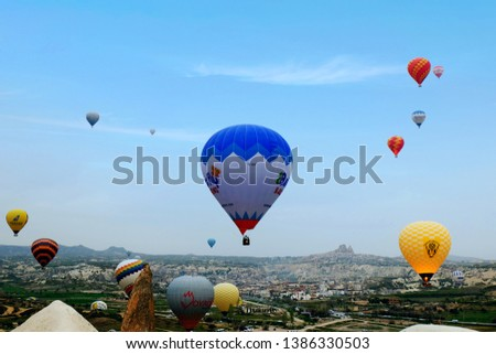 """Cappadocia, Turkey: Circa, April 2019: A morning picture of Cappadocia Hot Air Balloon during sunrise. Chinese have secure the deal for 1 million people each week for Cappadocia Hot Air Balloon."" #1386330503"