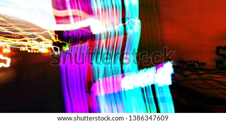 Light effects. Neon glow. Festive decoration. Abstract blurred background. Colorful pattern. #1386347609