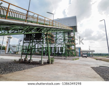 Belt conveyer of feed woof chipper fuel systems to boiler for product steam to steam turbine generator in biomass power plant. #1386349298