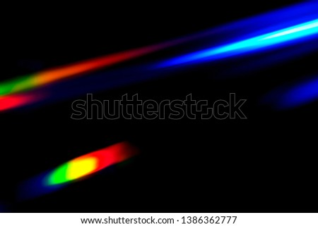 Abstract colorful spectrum in darkness. Colorful rays of light. #1386362777