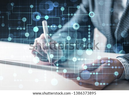 Project management and internet researching process. Man in business suit using tablet computer. Virtual geometric graphics with circle elements. Futuristic interface with glowing digital hologram #1386373895