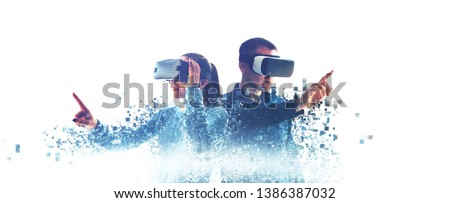 A man and a woman in glasses of virtual reality. The concept of modern technologies and technologies of the future. Fragmented by pixels. VR glasses. #1386387032