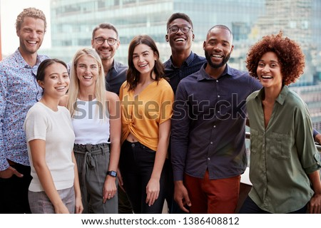 Group portrait of a creative business team standing outdoors, three quarter length, close up #1386408812