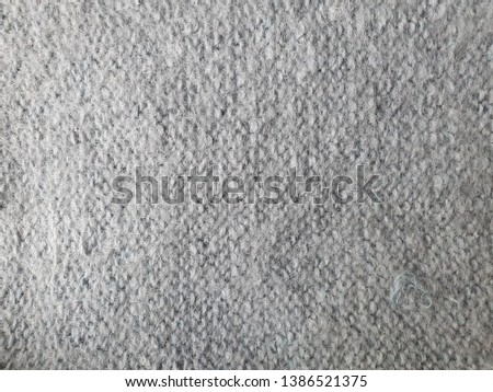Gray Textile Material Background - Wallpaper with a Knitted Clothing Texture,Braided Multi Colored Wool Texture, Ecological Modern Cloth, Rustic Textile Background, Fabrics Texture #1386521375