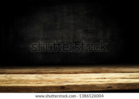 Wooden table background of free space for your decoration. Black shadow and wall of free space for your text.  #1386526004