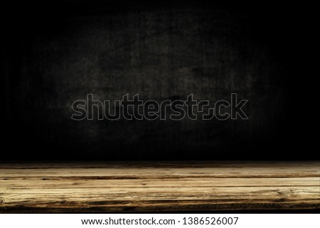 Wooden table background of free space for your decoration. Black shadow and wall of free space for your text.  #1386526007