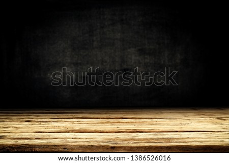 Wooden table background of free space for your decoration. Black shadow and wall of free space for your text.  #1386526016