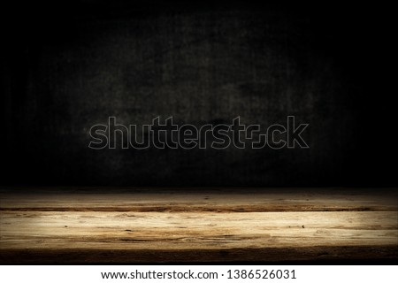 Wooden table background of free space for your decoration. Black shadow and wall of free space for your text.  #1386526031