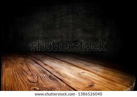 Wooden table background of free space for your decoration. Black shadow and wall of free space for your text.  #1386526040