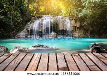 Wooden bridge with the waterfall in the background, The wooden nature trail to see the scenery of beautiful waterfall and forest #1386551066