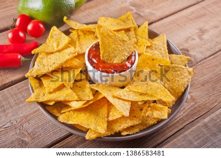 Mexican corn chips nachos with salsa dip #1386583481