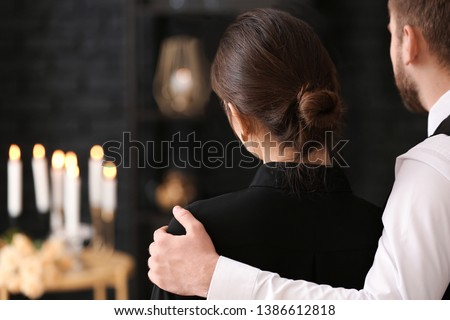 Couple pining after their relative at funeral #1386612818