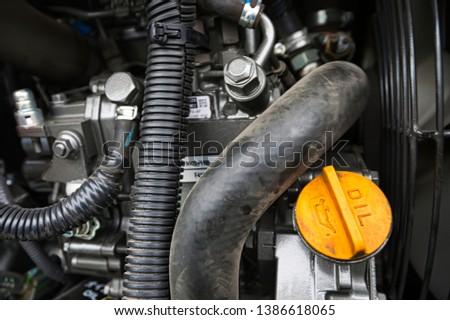 Yellow engine oil filler cap of an diesel engine #1386618065