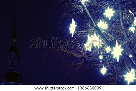 Wonderful Christmas. The Stars of Bethlehem on the streets encouraging residents - guiding star, guiding light #1386650009