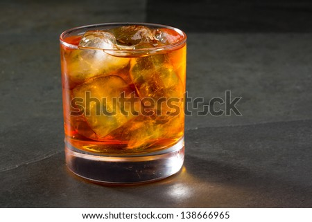 Whiskey whisky on the rocks on glass over gray black background #138666965