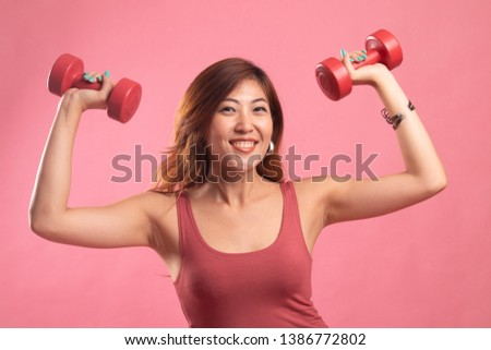Healthy Asian woman with dumbbells on pink background #1386772802