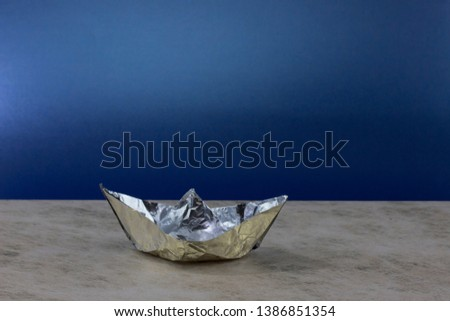 paper boat made of aluminum foil. A romantic journey at a beautiful night