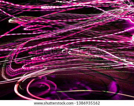 Light effects. Neon glow. Festive decoration. Abstract blurred background. Colorful pattern. #1386935162