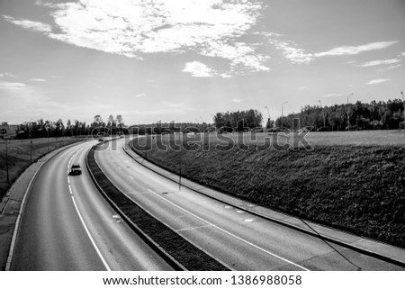 Highway. Track with cars. Car track at sunset. Russia, Leningrad region, St. Petersburg July 12, 2018 #1386988058