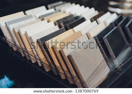 Kitchen bathroom tiles showroom display of new tiling option for floors and walls for home building improvement works. Royalty-Free Stock Photo #1387000769