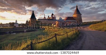 Sunset view on the Solovetsky Monastery. Russia, Arkhangelsk region, White sea, Solovki. Iconic view, Solovki Kremlin. Famous Russian Landmark Of North. #1387024469