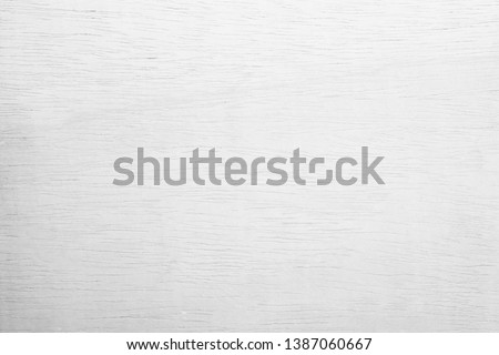 White plywood textured wooden background or wood surface of the old at grunge dark grain wall texture of panel top view. Vintage teak surface board at desk with light pattern natural copy space. #1387060667
