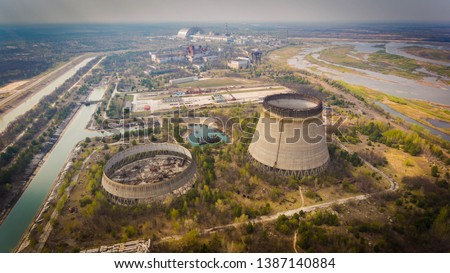 Aerial shot of Chernobyl nuclear reactors with straight canals around in spring #1387140884