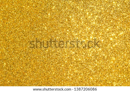 sparkle of golden glitter texture background #1387206086