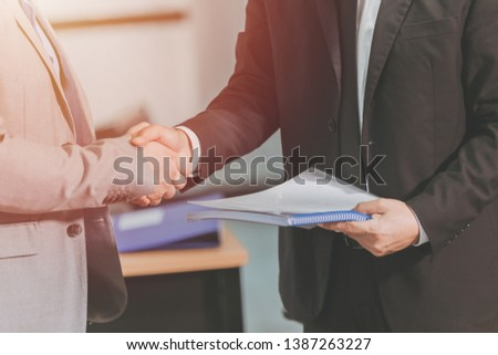 businessman hand shake together for project successful job done or dealing contract agenda finish concept. #1387263227