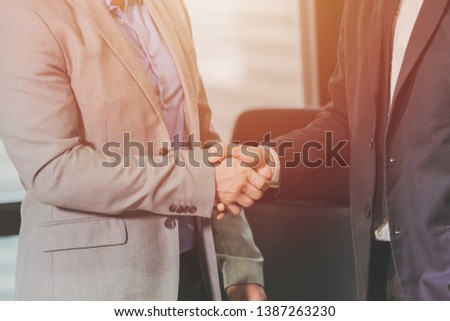 two businessman handshake for working successful job done or dealing contract in office. #1387263230
