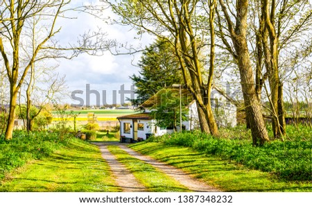 Farm house road landscape view. Rural road at farm house. Farm house road view. Road to farm house #1387348232