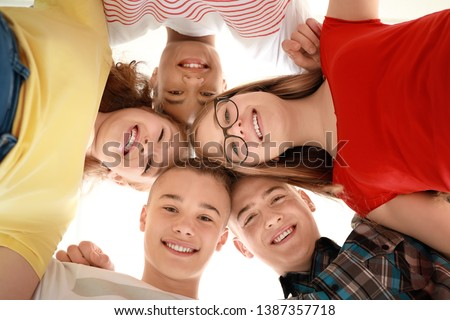 Portrait of teenagers on white background, bottom view Royalty-Free Stock Photo #1387357718