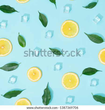 Creative summer background composition with lemon slices, leaves and ice cubes. Minimal top down lemonade drink concept. #1387369706