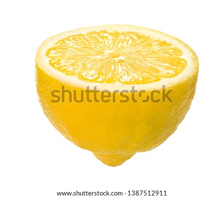 fresh and juicy lemon cut in half #1387512911