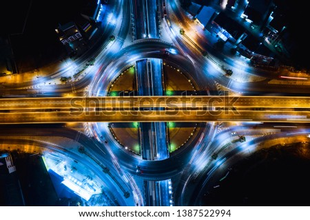 long exposure night traffic head light car on the ring road and freeways overpass intersection connecting the city transportation logistics business in Thailand aerial over view from drone camera #1387522994