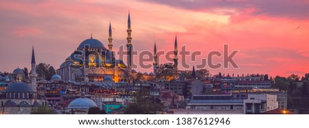 Sunset in Istanbul, Turkey with Suleymaniye Mosque (Ottoman imperial mosque). View from Galata Bridge in Istanbul. #1387612946