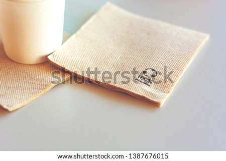 Disposable biodegradable napkin made from recycled paper. Environmental protection and ecology. #1387676015