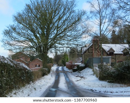 Tiny little village covered in snow, set in the heart of the British countryside #1387700960