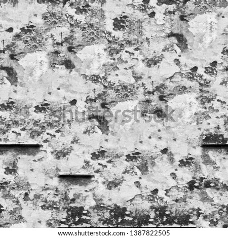 Wall background with scratches and cracks texture in black and white tones #1387822505