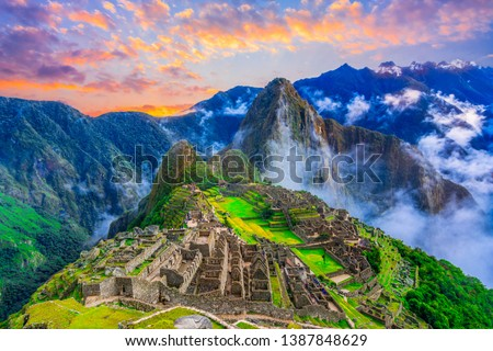 Machu Picchu, Cusco,Peru: Overview of the lost inca city Machu Picchu, agriculture terraces and Wayna Picchu, peak in the background,before sunrise #1387848629