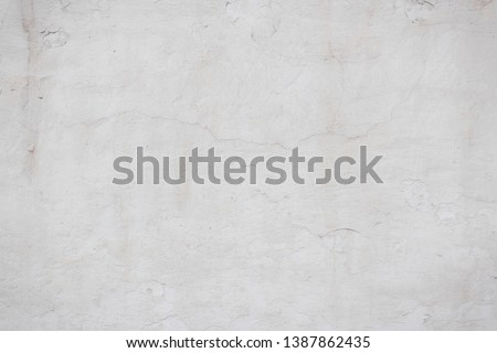 The texture of the old concrete wall with scratches, cracks, dust, crevices, roughness, stucco. Can be used as a poster or background for design. #1387862435