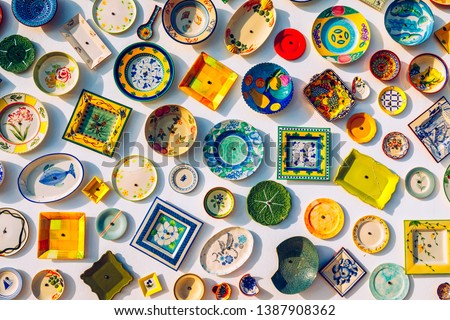 Collection of colorful Portuguese ceramic pottery, local craft products from Portugal. Ceramic plates display in Portugal. Colorful of vintage ceramic plates in Sagres, Portugal. #1387908362